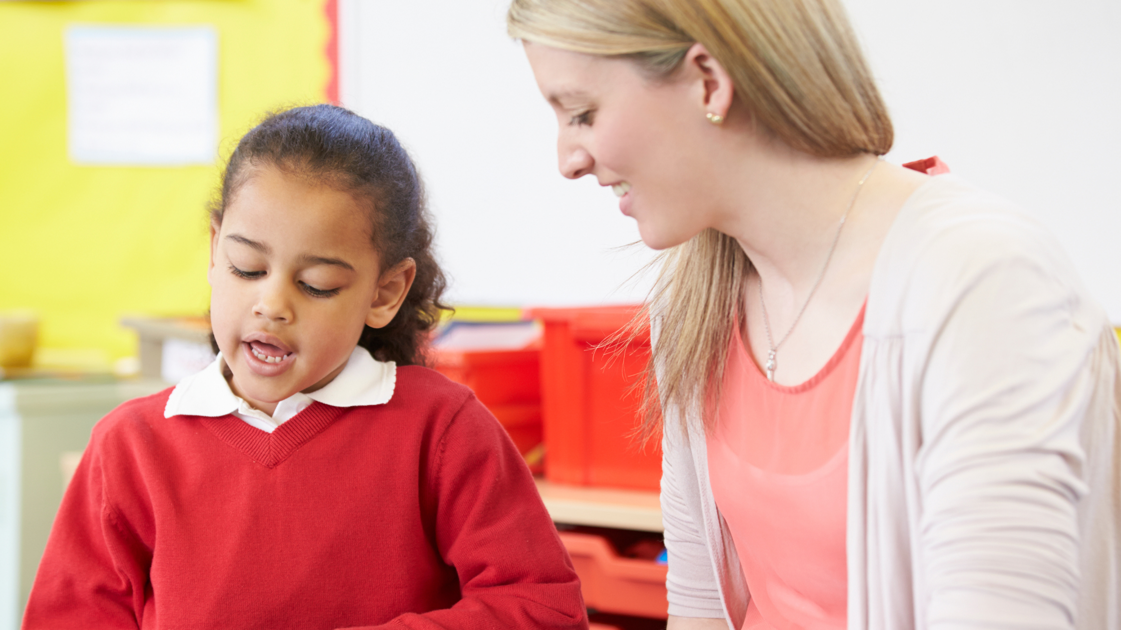 A teacher supports a learner